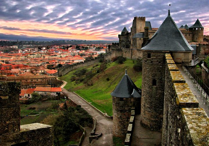 Carcassonne is a fortified French town in the Aude department, of which it is the prefecture, in the former province of Languedoc