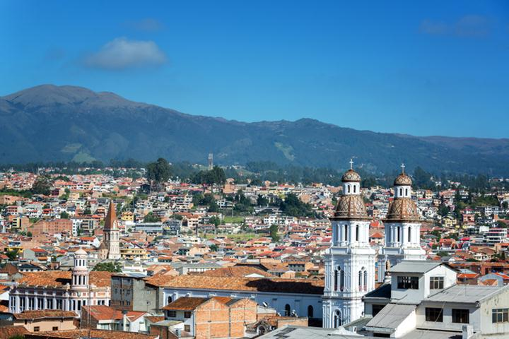 Cityscape of Cuenca, Ecuador with Santo Domingo church visible in the bottom right